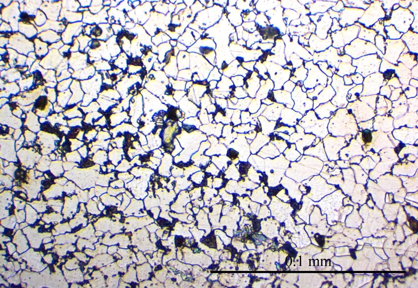 Mikroskopbilde av strukturen i jern. De lyse kornene er rent jern, mens de mørke har høyt karboninnhold.